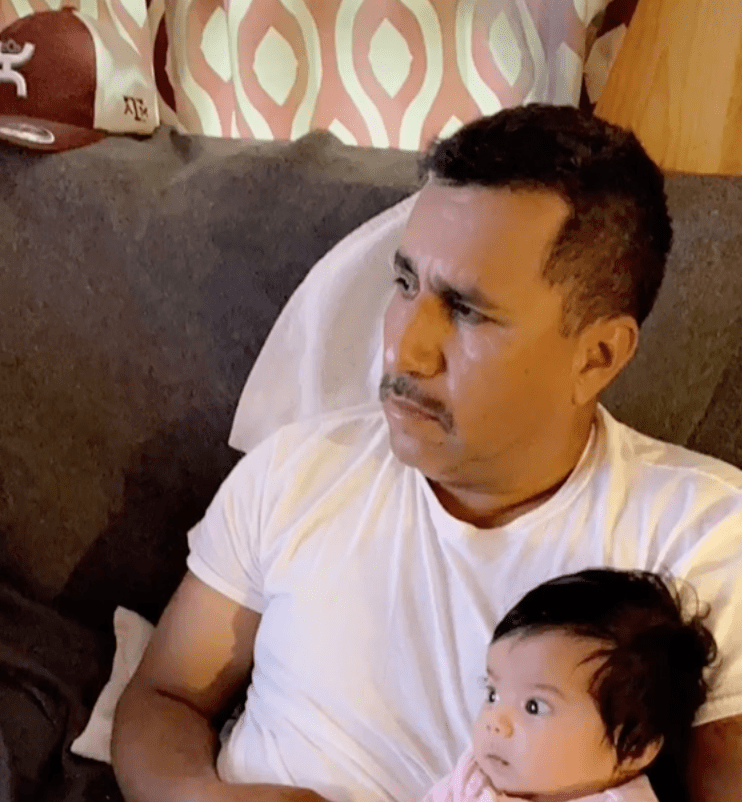 In a viral TikTok clip a mother pans camera to show her father as he cuddles his new grandchild | Photo: TikTok/vanessaguilars
