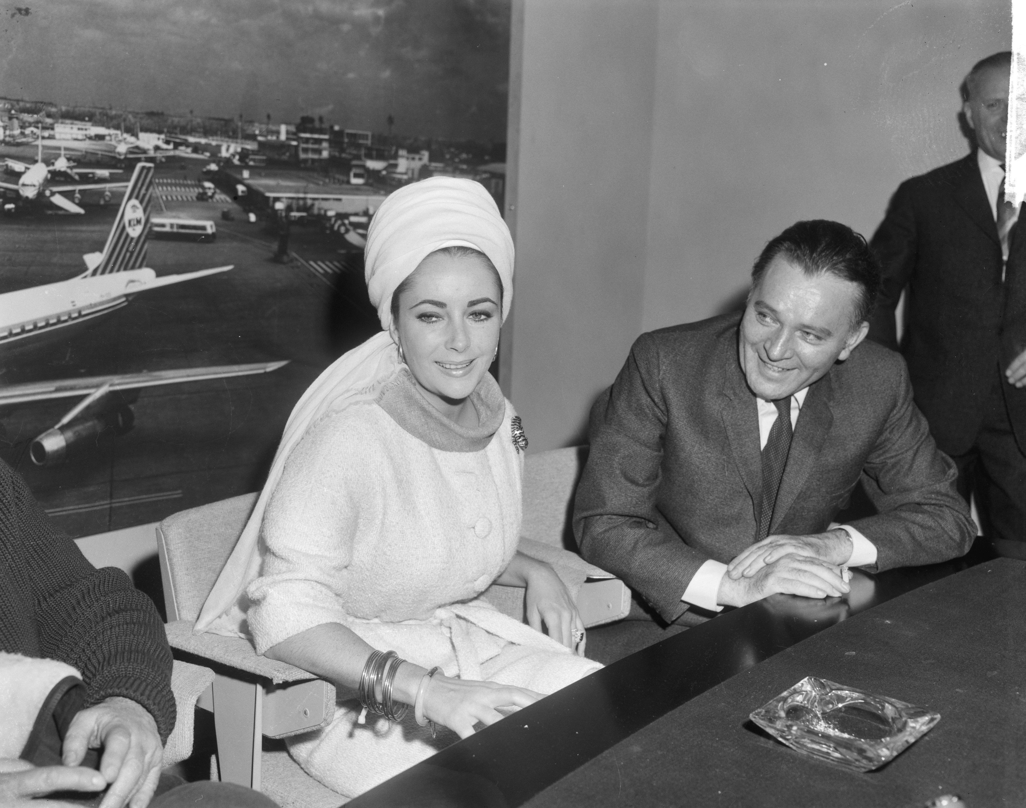 "Elizabeth Taylor and Richard Burton during press conference at Schiphol for ""The Spy Who Came In From The Cold."" 