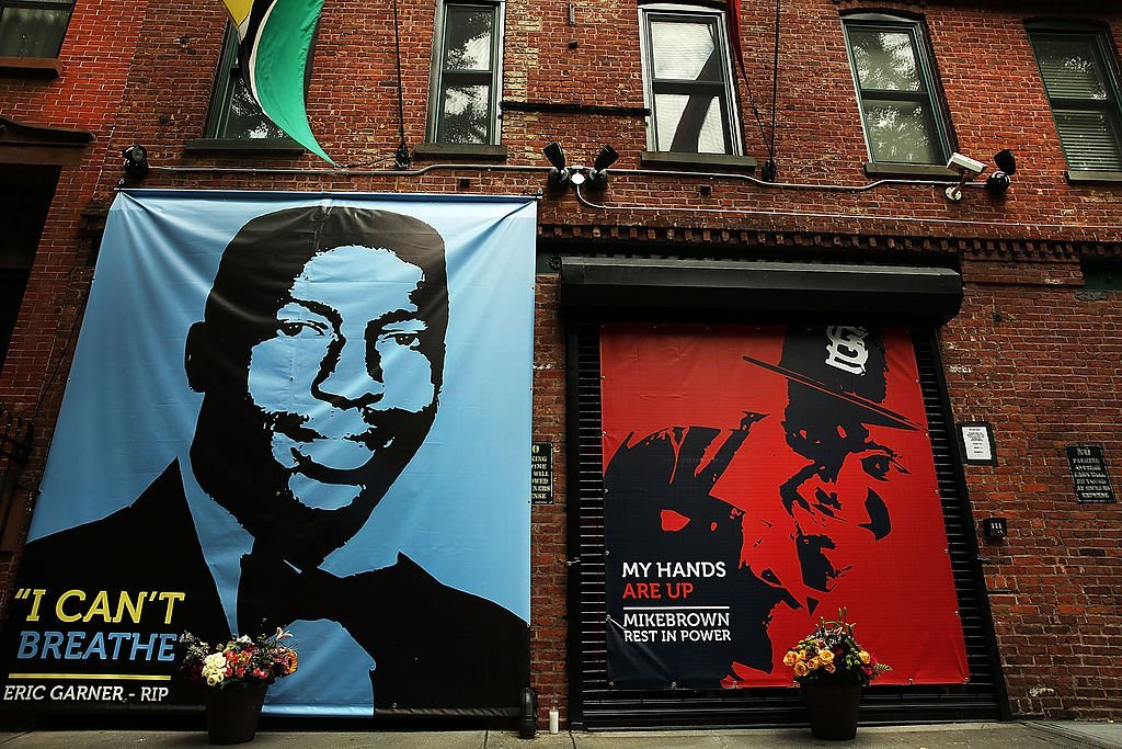 A memorial of Michael Brown, 18, next to the one of Eric Garner, is viewed outside of filmmaker's Spike Lee's 40 Acres offices | Photo: Getty Images