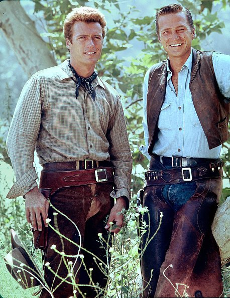 "Clint Eastwood and Eric Fleming pose for a portrait on the set of the television series ""Rawhide,"" circa 1963. 