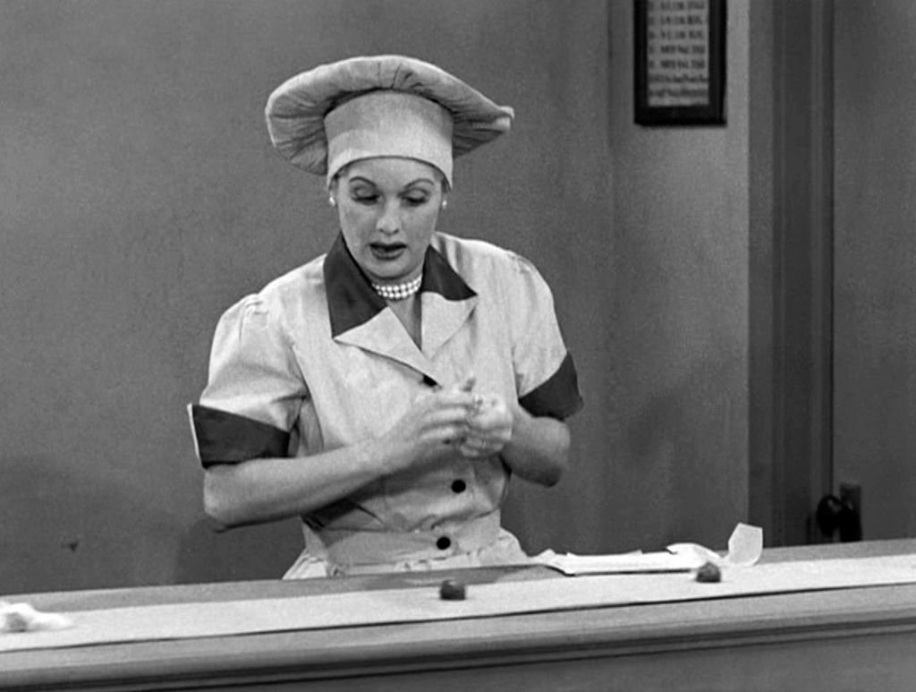 American comedienne and actress Lucille Ball as Lucy Ricardo, works at a candy factory conveyor belt in an episode of the television comedy 'I Love Lucy' entitled 'Job Switching' | Source: Getty Images
