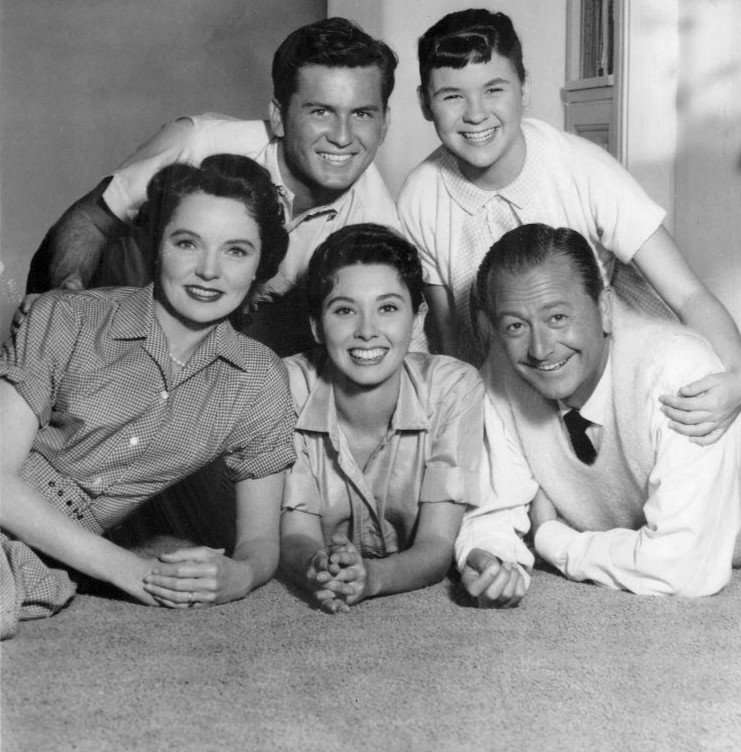 "Photo of the cast of "" Father Knows Best."" Top, from left: Billy Gray, Lauren Chapin. Bottom, from left: Jane Wyatt, Elinor Donahue, Robert Young. 
