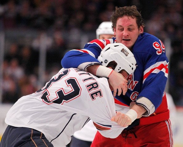 Steve MacIntyre #33 of the Edmonton Oilers fighting with Derek Boogaard #94 of the New York Rangers during a hockey game at Madison Square Garden on November 14, 2010, in New York City. | Source: Getty Images.