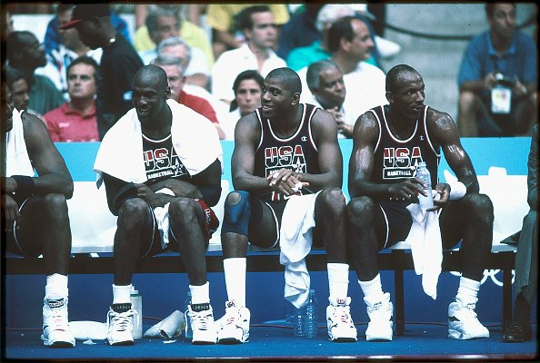 Michael Jordan (L), Magic Johnson (M) and Clyde Drexler (R) of Team USA, the Dream Team, sit on the bench during the men's basketball competition at the 1992 Summer Olympics in Barcelona, Spain | Source: Getty Images