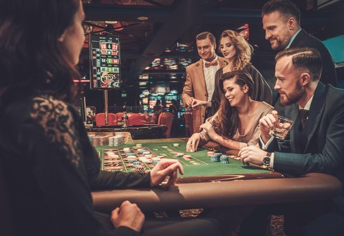 People gambling at a casino. | Source: Shutterstock.