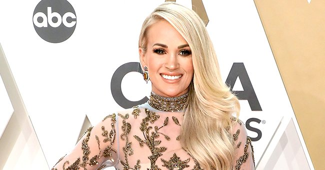 Carrie Underwood Steals Spotlight at 2019 CMA Awards in Sheer Gold Gown with a Tulle Train