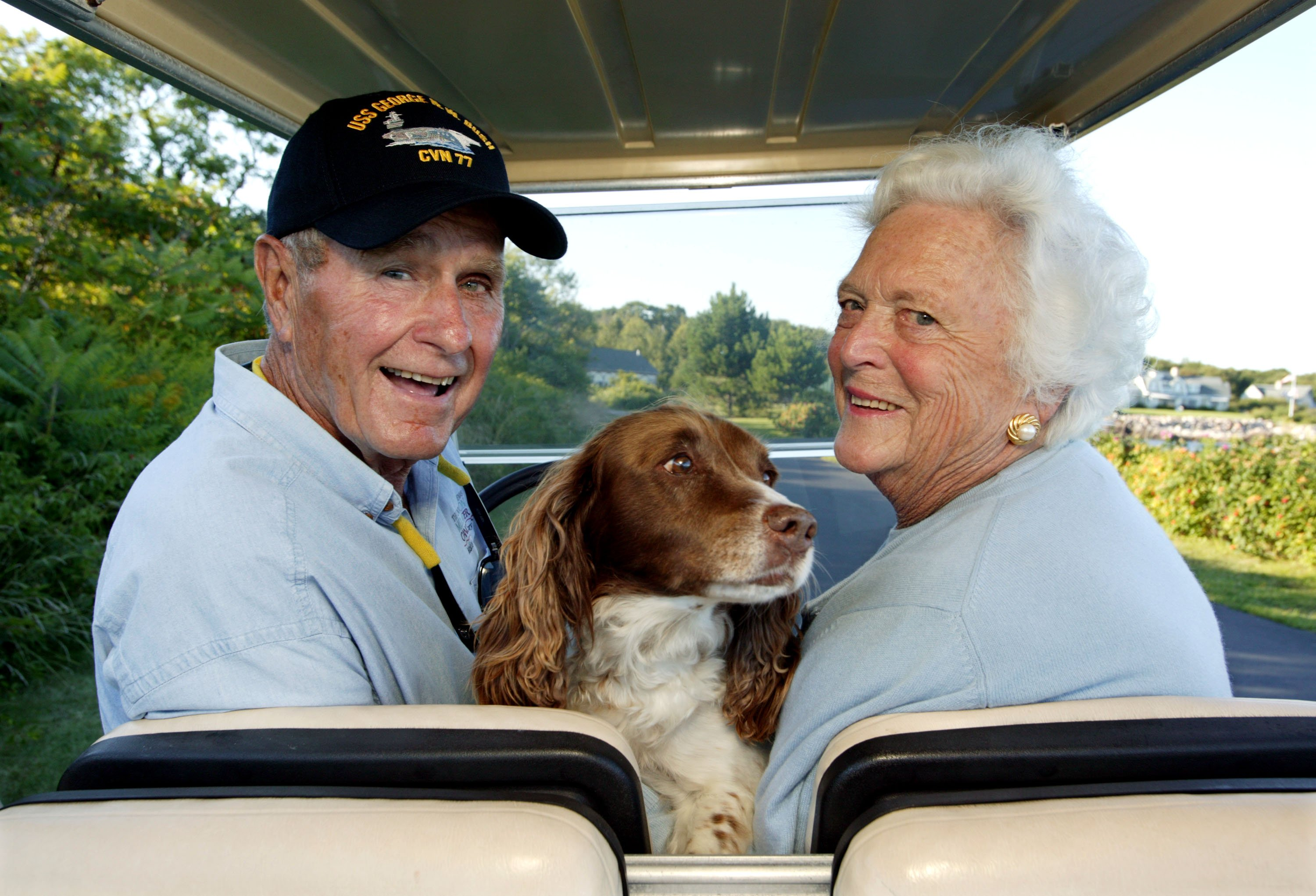 Former U.S. president George H. W. Bush and wife, Barbara Bush, cruise in the back of a golf cart with their dog Millie at their home at Walker's Point August 25, 2004 in Kennebunkport, Maine.  Source: Getty Images