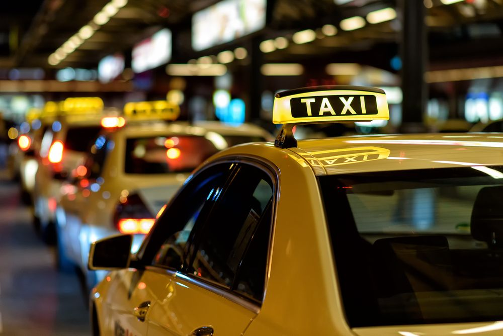 Several taxis lined up on the road. | Source: Shutterstock