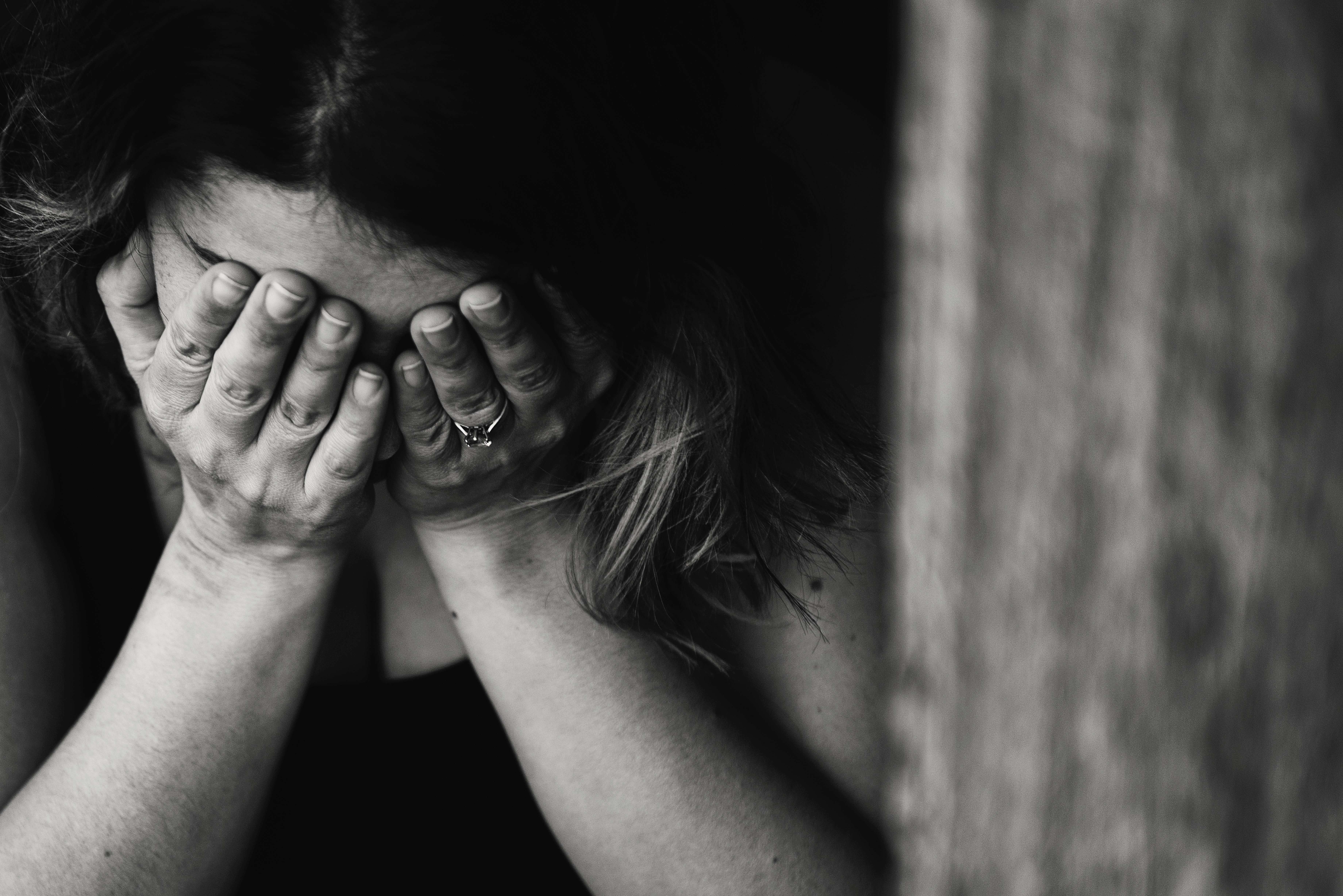 The woman looked distressed and sobbed to the ground   Photo: Pexels