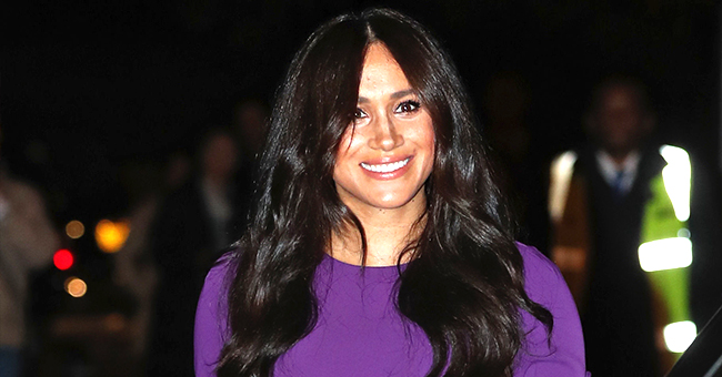 Meghan Markle Smiles in Her Purple Midi-Dress during First Outing since Candid Interview Aired