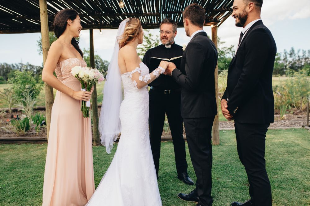 A bride and a groom getting married outdoors.   Source: Shutterstock