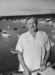 Ernest Hemingway pictured in  front of harbor dotted with small boats.   Photo: Getty Images