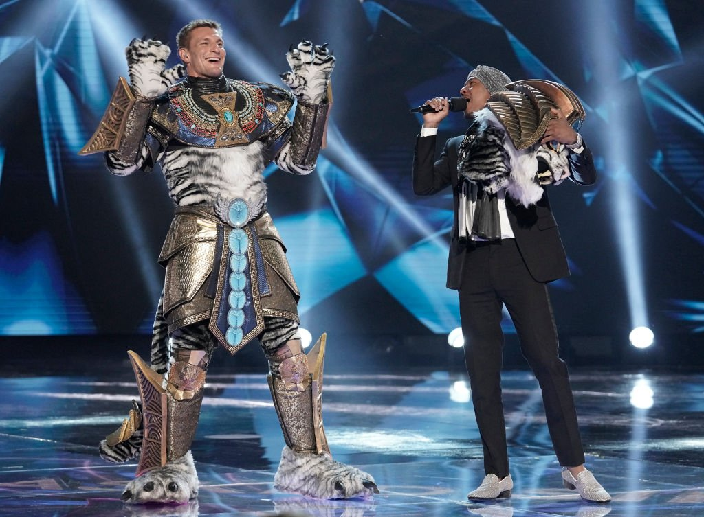 Host Nick Cannon and Rob Gronkowski in The Super Nine Masked Singer Special: Groups A, B & C special two-hour episode of THE MASKED SINGER airing Wednesday, April 1 | Photo: Getty Images