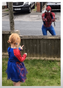Jason Baird from Stockport pictured cheering up a young girl in his Spider-Man suit, 2020, England. | Photo: Getty Images