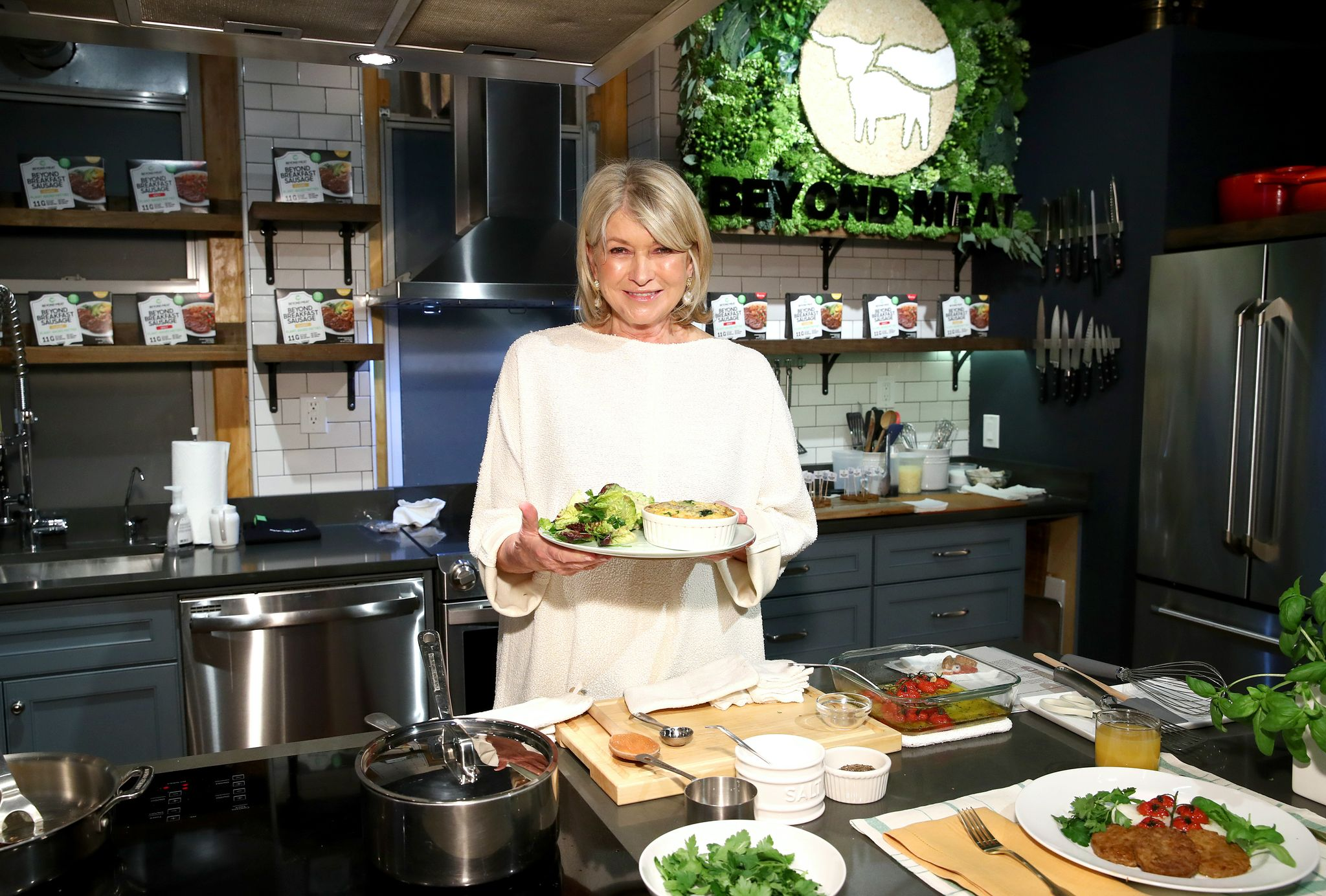 Martha Stewart prepares the Classic Beyond Breakfast Sausage with spinach and sweet onion frittata on March 10, 2020 in New York City | Source: Getty Images