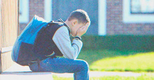 A student sitting by the side of the road.   Photo: Shutterstock