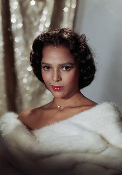 Dorothy Dandridge wearing a white fur wrap in undated publicity still   Photo: Getty Images