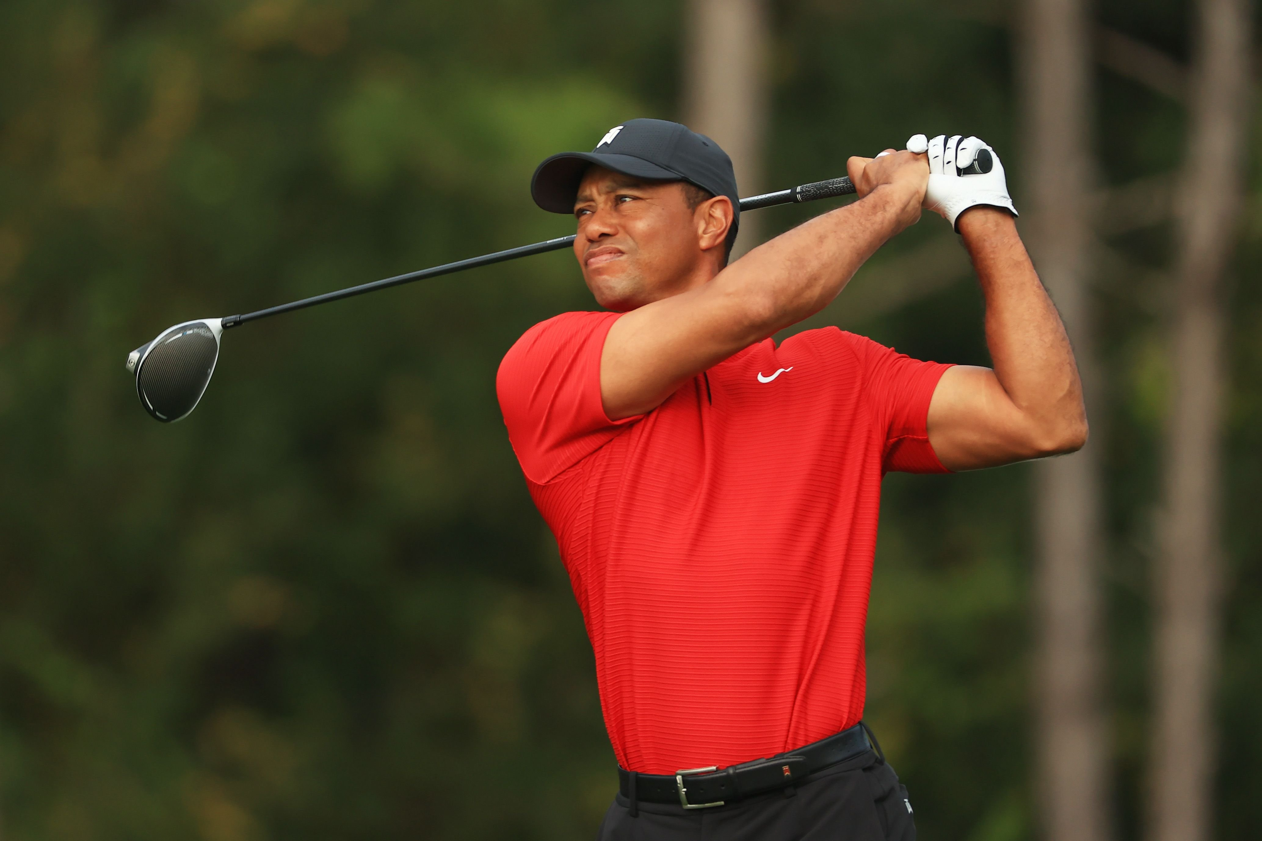 Tiger Woods plays during the final round of the PNC Championship at the Ritz-Carlton Golf Club Orlando on December 20, 2020 | Getty Images