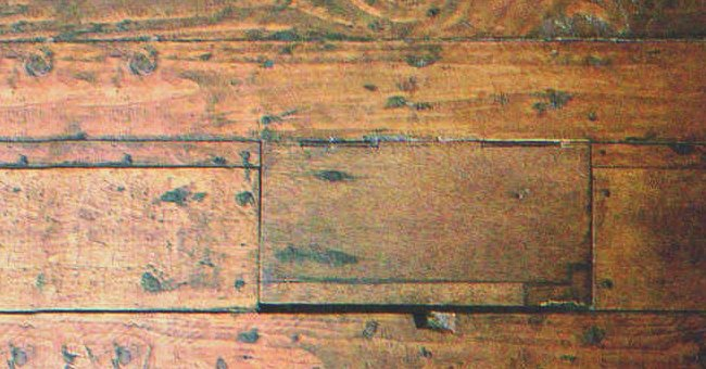 I discovered a loose floorboard in my grandparent's closet.   Source: Shutterstock