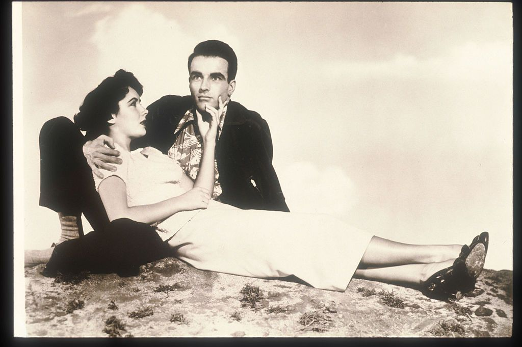 """A portrait of Elizabeth Taylor And Montgomery Clift from the film """"A Place In The Sun"""", 1951   Photo: Getty Images"""