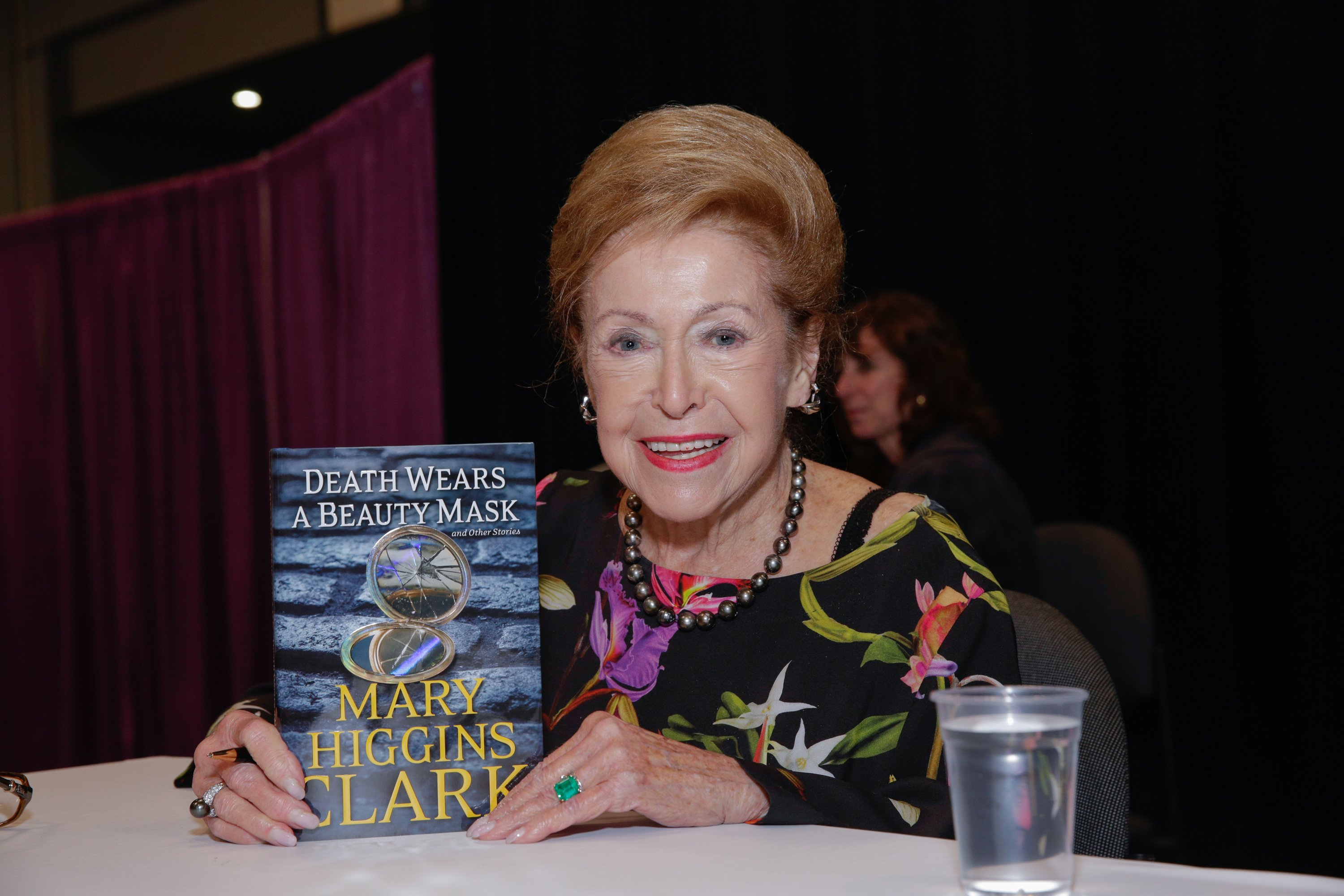 Mary Higgins Clark posing for photographs with her book during BookExpo America at the Javits Center in New York City | Photo: Brent N. Clarke/FilmMagic via Getty Images