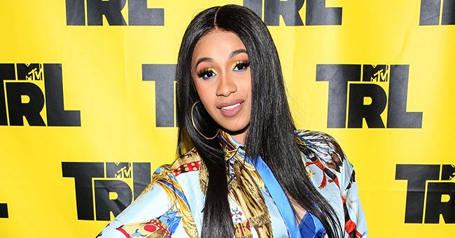 Check Out Cardi B's Cool Purple Smokey Makeup That She Paired with Long Matching Nail Art