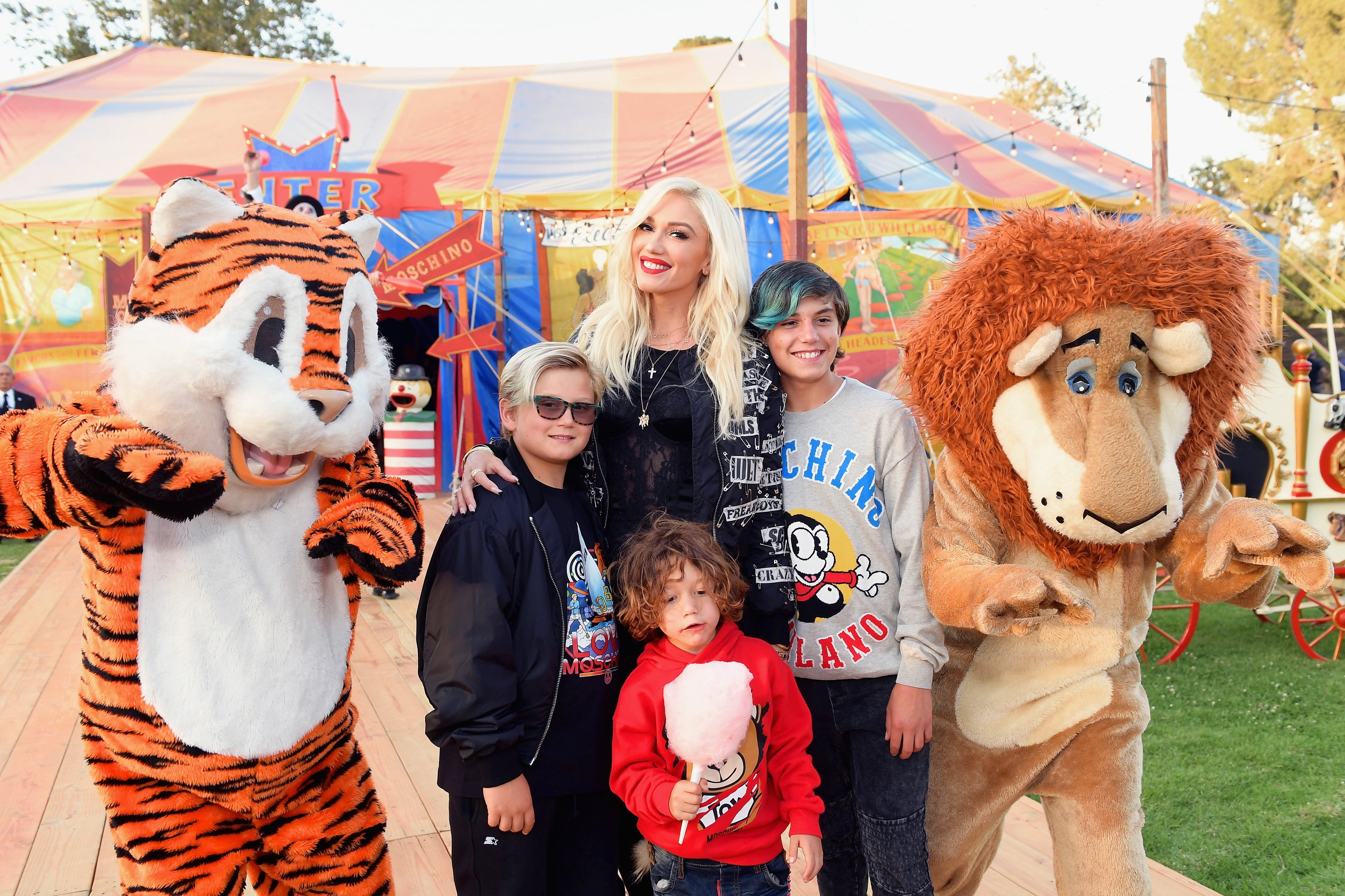 Gwen Stefani with sons Zuma, Apollo, and Kingston Rossdale at the Moschino Spring/Summer 19 Menswear and Women's Resort Collection on June 8, 2018, in Burbank, California | Photo: Matt Winkelmeyer/Getty Images