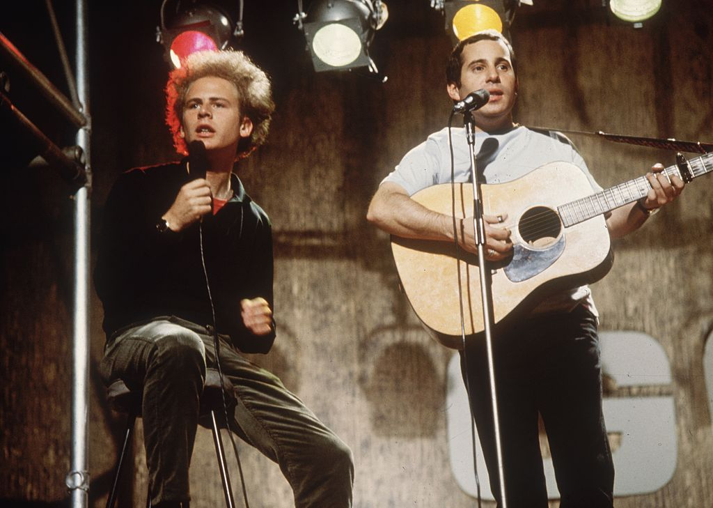 Pop duo Simon and Garfunkel performing on ITV's 'Ready, Steady, Go!', July 8, 1966. | Photo: Getty Images