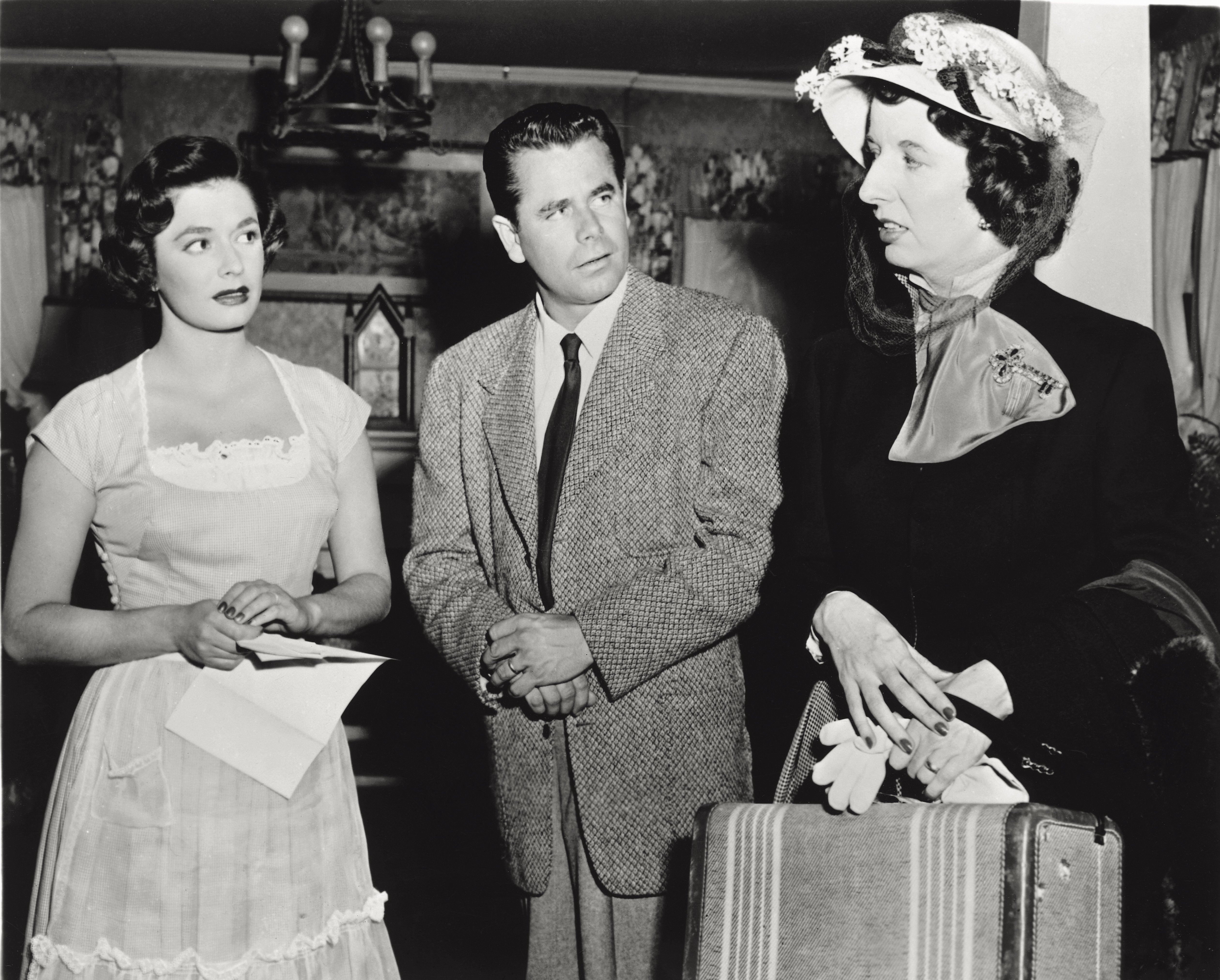 Actors Ruth Roman, Glenn Ford and Mary Wickes in 'Young Man with Ideas'. Ruth Roman, as Julie Webster, and Glenn Ford, as Maxwell Webster, interject with Mary Wickes, as Mrs. Jasper Gilpin. 1952.   Source: Getty Images
