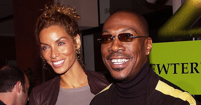 Check Out Nicole Murphy's Toned Body in a Swimsuit & Matching Pareo While Walking in High Heels