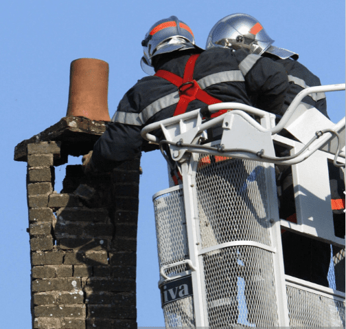 Firemen getting someone unstuck from the chimney | Source: Getty Images