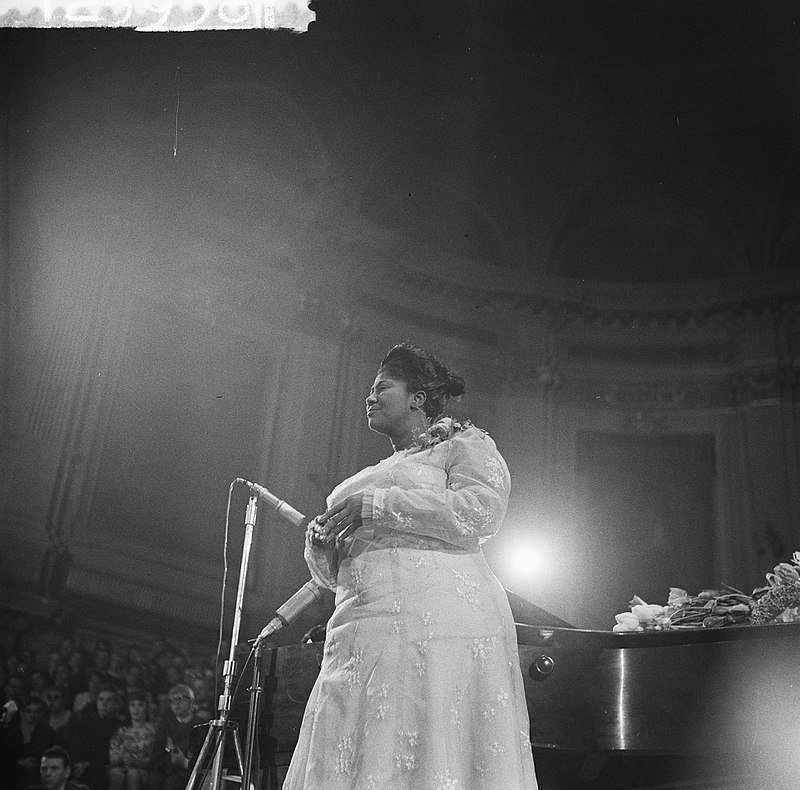 Portrait of Mahalia Jackson during a musical perfomance   Photo By Dave Brinkman / Anefo - CC0, Wikimedia Commons