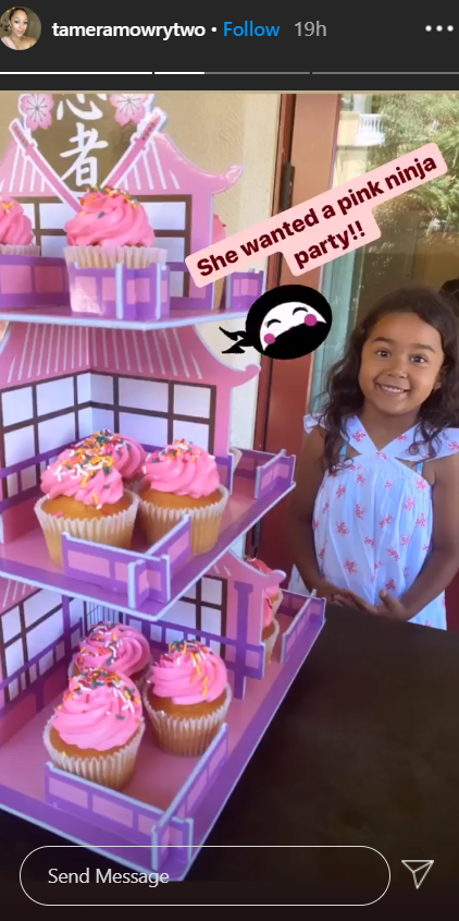 Ariah Housley standing in front of cupcakes as she celebrates her fifth birthday | Photo: Instagram/tameramowrytwo