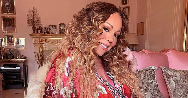 Mariah Carey Looks Radiant at 50 While Posing with a Sunflower (Photo)
