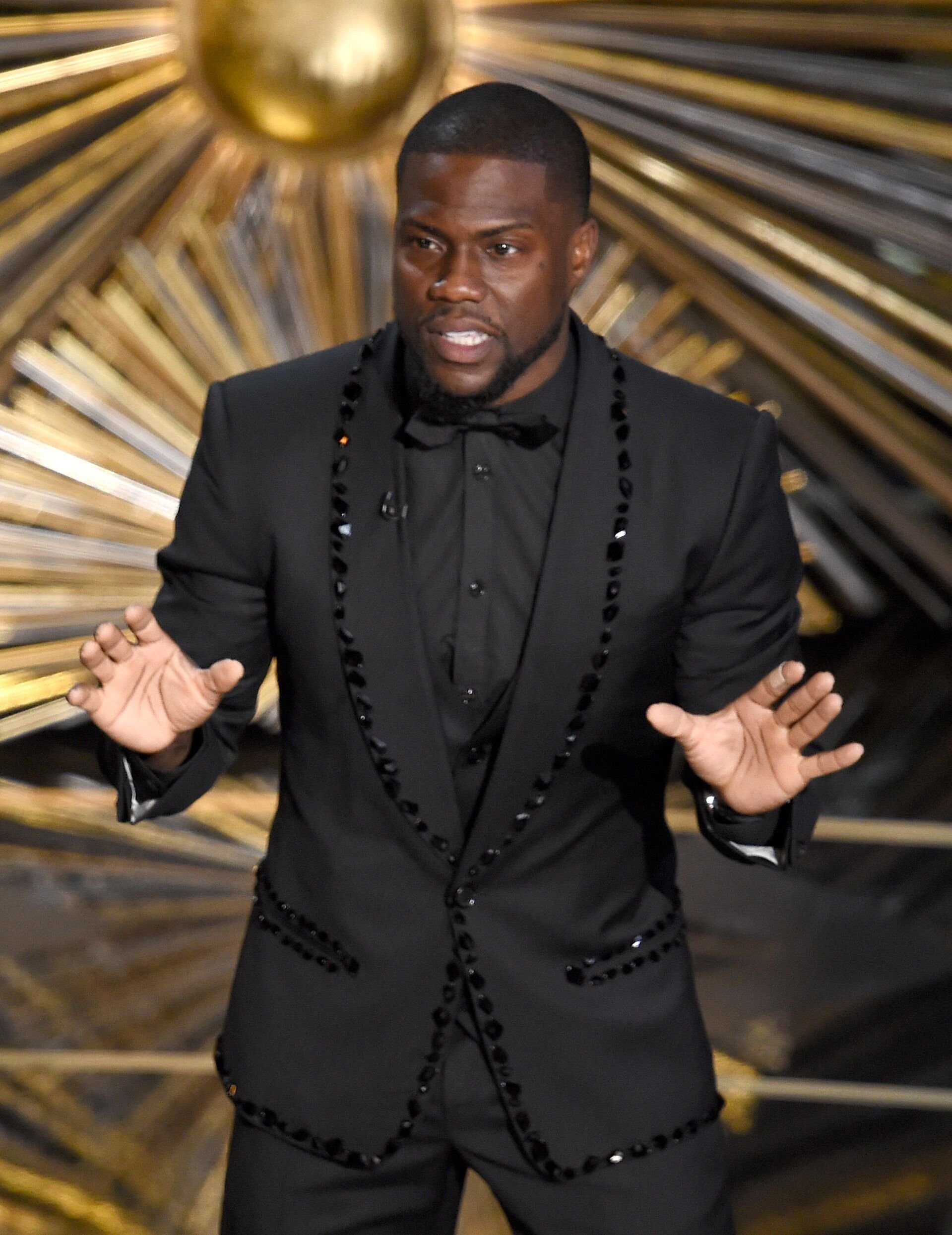 Kevin Hart hosting an awards night onstage | Source: Getty Images/GlobalImagesUkraine