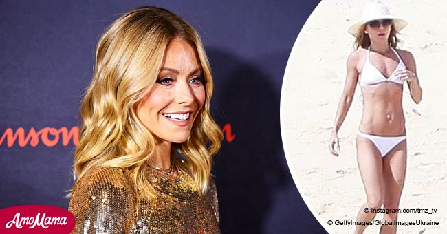 Kelly Ripa flaunts her rock-hard abs in a racy bikini as she enjoys a beach getaway with husband