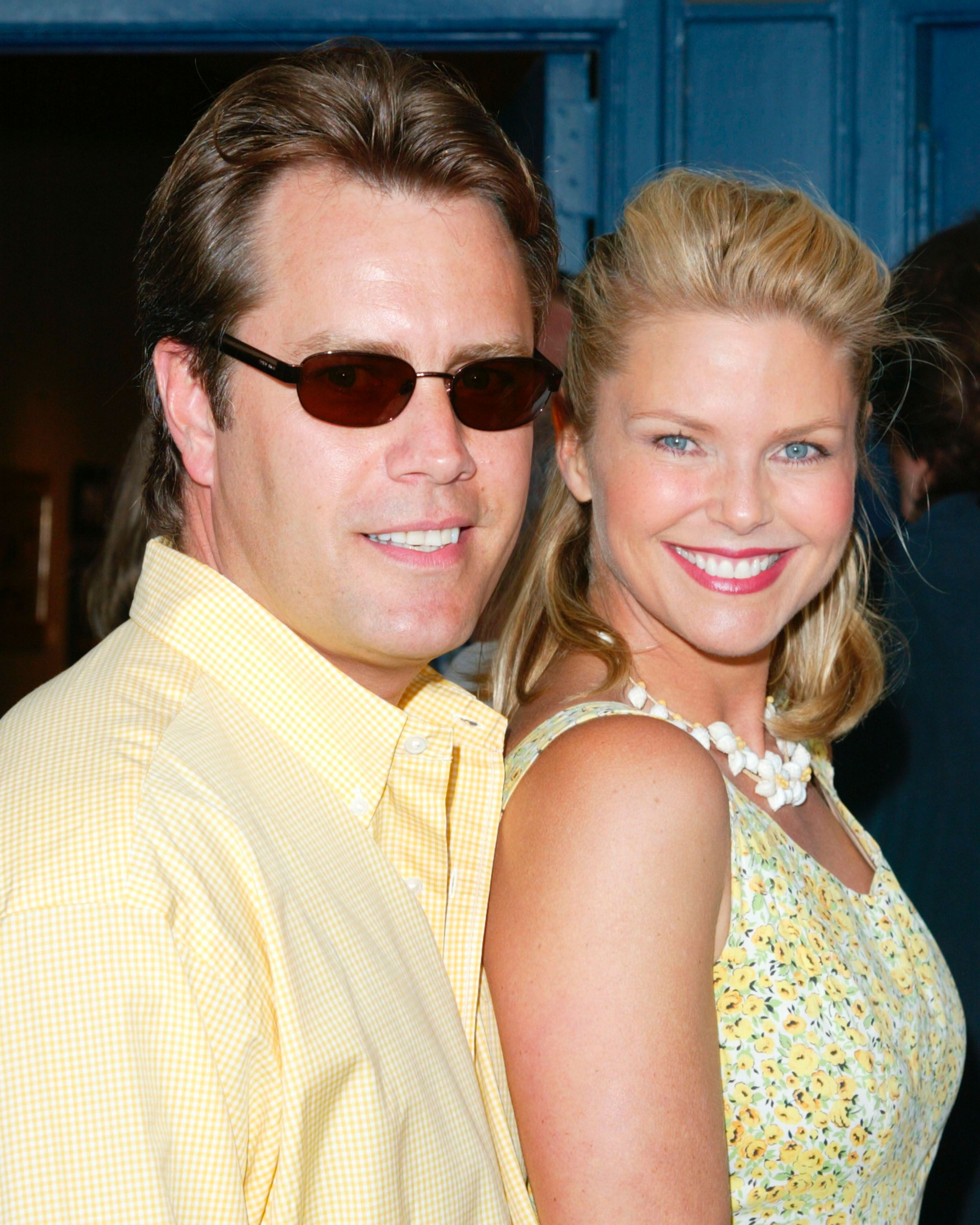 "Christie Brinkley (R) and Peter Cook (L) arrive for the premiere of ""The Hamptons"" June 1, 2002 in Sag Harbor, NY. 