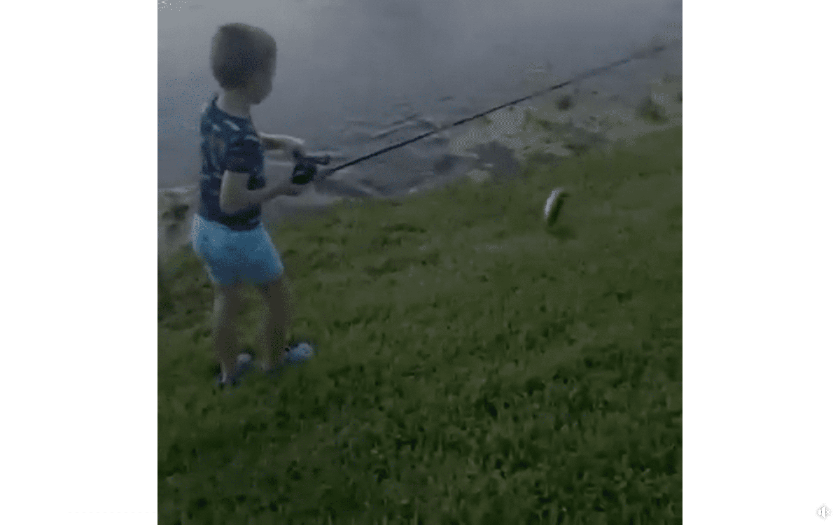 Sean McMahon cheers on his son as he catches a fish and drags it onto the land. | Photo: Facebook/Wesh2News