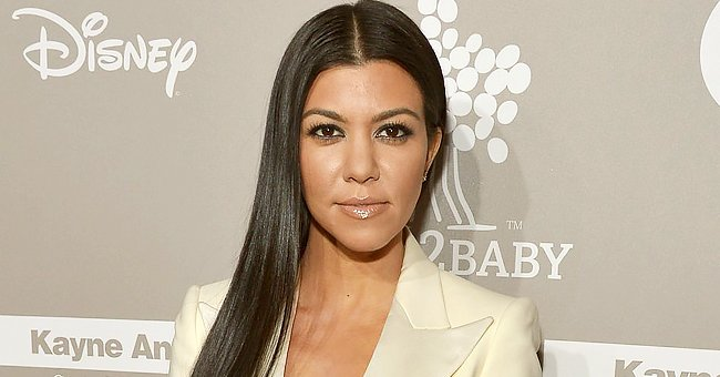 See Kourtney Kardashian's Heartwarming Throwback Snap Cuddling in Bed with Adorable Son Reign