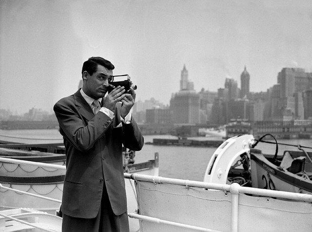 Cary Grant takes pot shots with his camera at the New York skyline, as he comes up the bay on the S.S. Ile de France on July, 8 1938   Photo: Getty Images