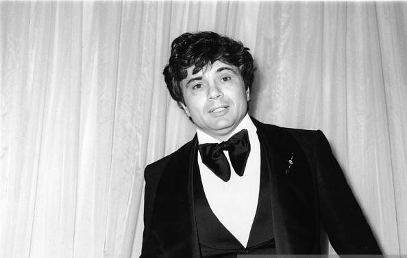 American actor Robert Blake stands at the Emmy Awards holding a cigarette in Hollywood, California in 1975   Photo: Getty Images