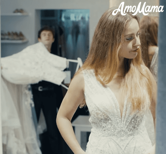 Trying on dresses   Source: Facebook/ AmoMama