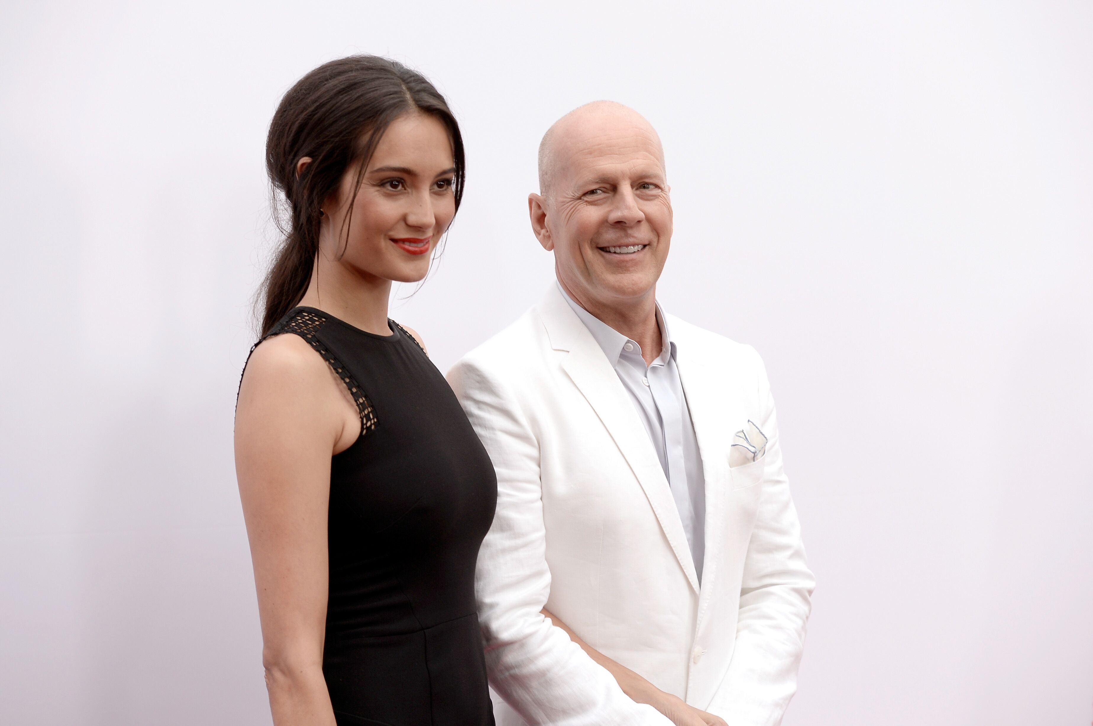 """Bruce Willis and Emma Heming attend the premiere of """"RED 2"""" at Westwood Village on July 11, 2013 