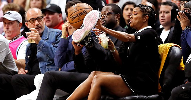 Dwyane Wade Uses Foot to Protect Wife Gabrielle Union from a Flying Ball in Hilarious yet Sweet Pic