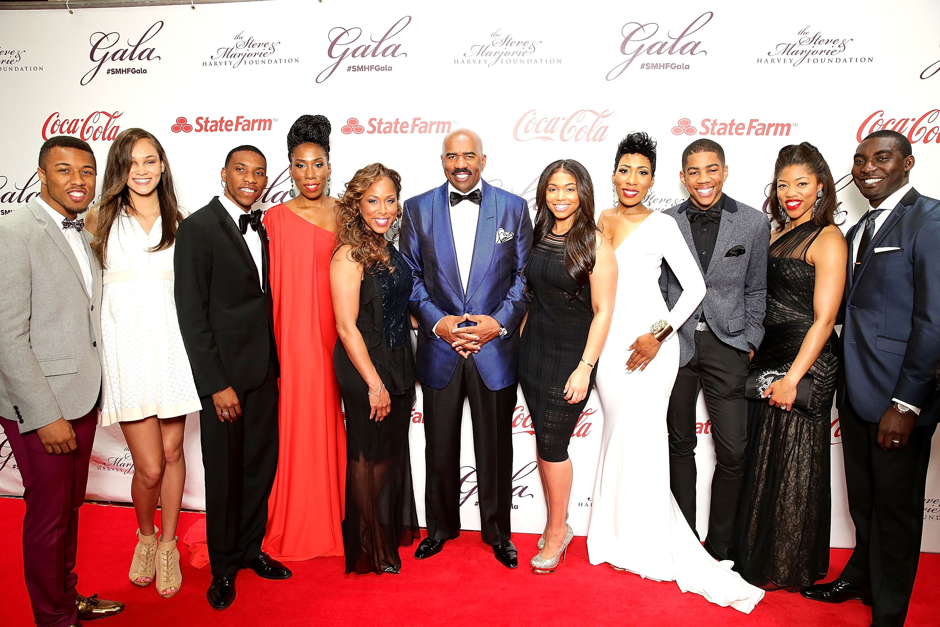 Steve and Marjorie Harvey's blended family in 2014. From left to right, Jason Harvey with wife, Amanda, Broderick Harvey, Jr., Brandi Harvey, Marjorie and Steve, Lori Harvey, Karli Harvey, Wynton Harvey, Morgan Hawthorne and husband, Kareem. | Photo: Getty Images