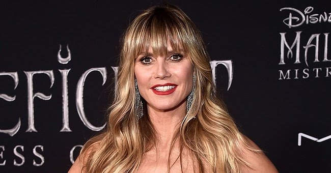 Watch Heidi Klum Flaunt Her Perfect Endless Legs in a Flowy Maxi Skirt & Bright Yellow Bodysuit