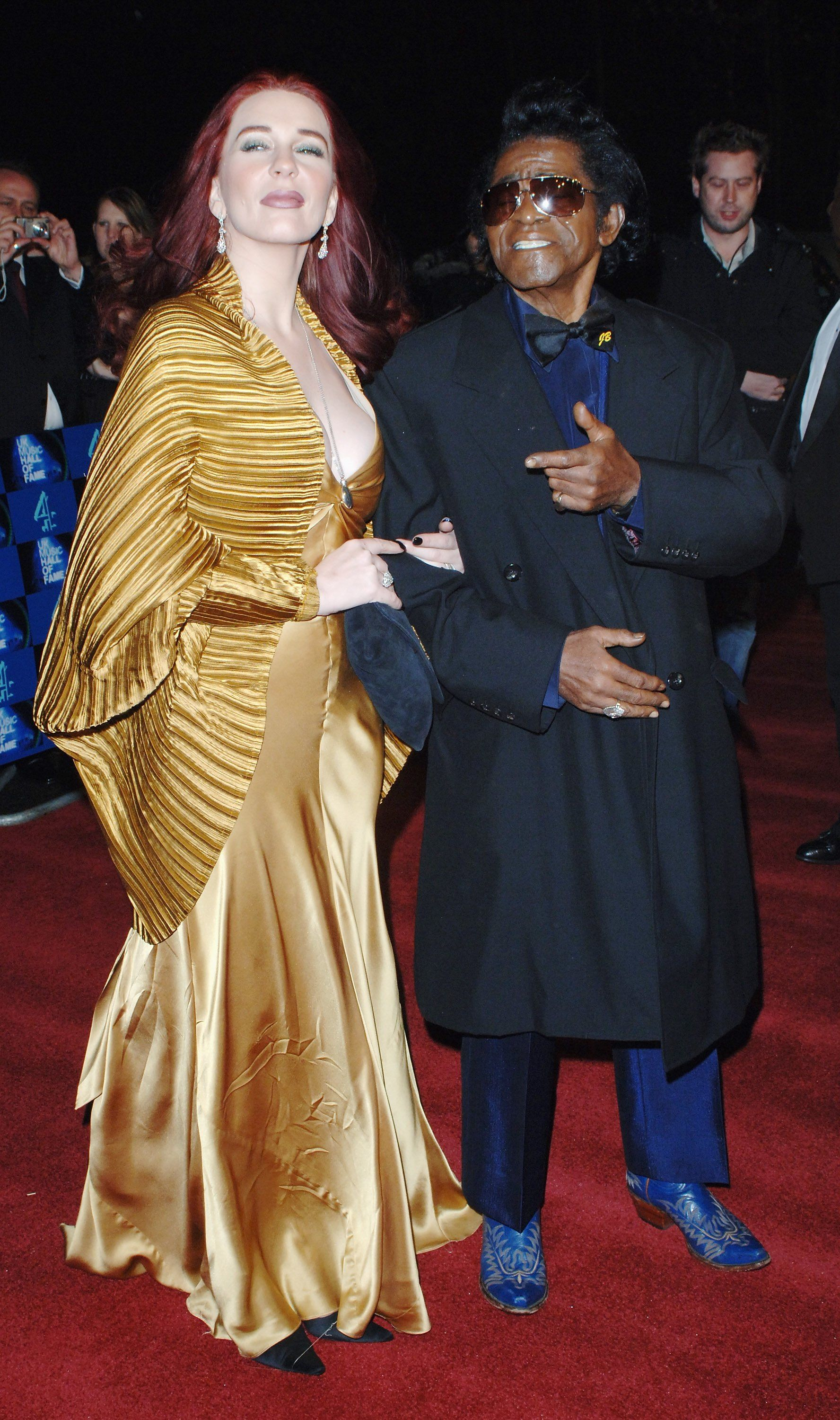 James Brown with Tomi Rae Hynie at the UK Music Hall Of Fame 2006, at Alexandra Palace on November 14, 2006 | Photo: Getty Images