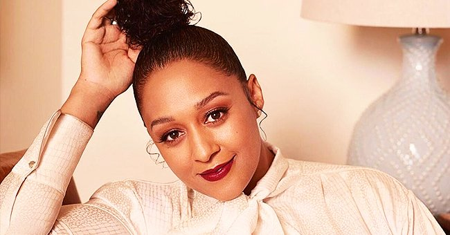 Watch Tia Mowry Strut like a Model Dressed in Green Outfit & High Heels in a Cool Video