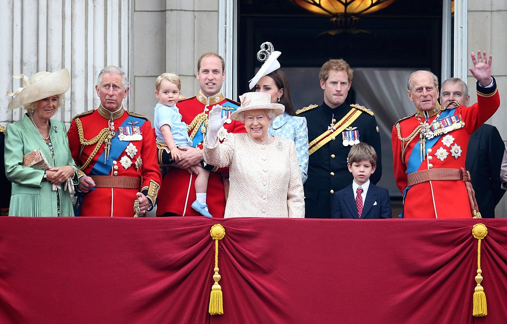 Duchess of Cornwall, Prince Charles, Prince George, Prince William, Kate Middleton, Queen Elizabeth II, Prince Harry and Prince Philip watch the fly-past from the balcony of Buckingham Palace on June 13, 2015 in London, England | Photo: Getty Images