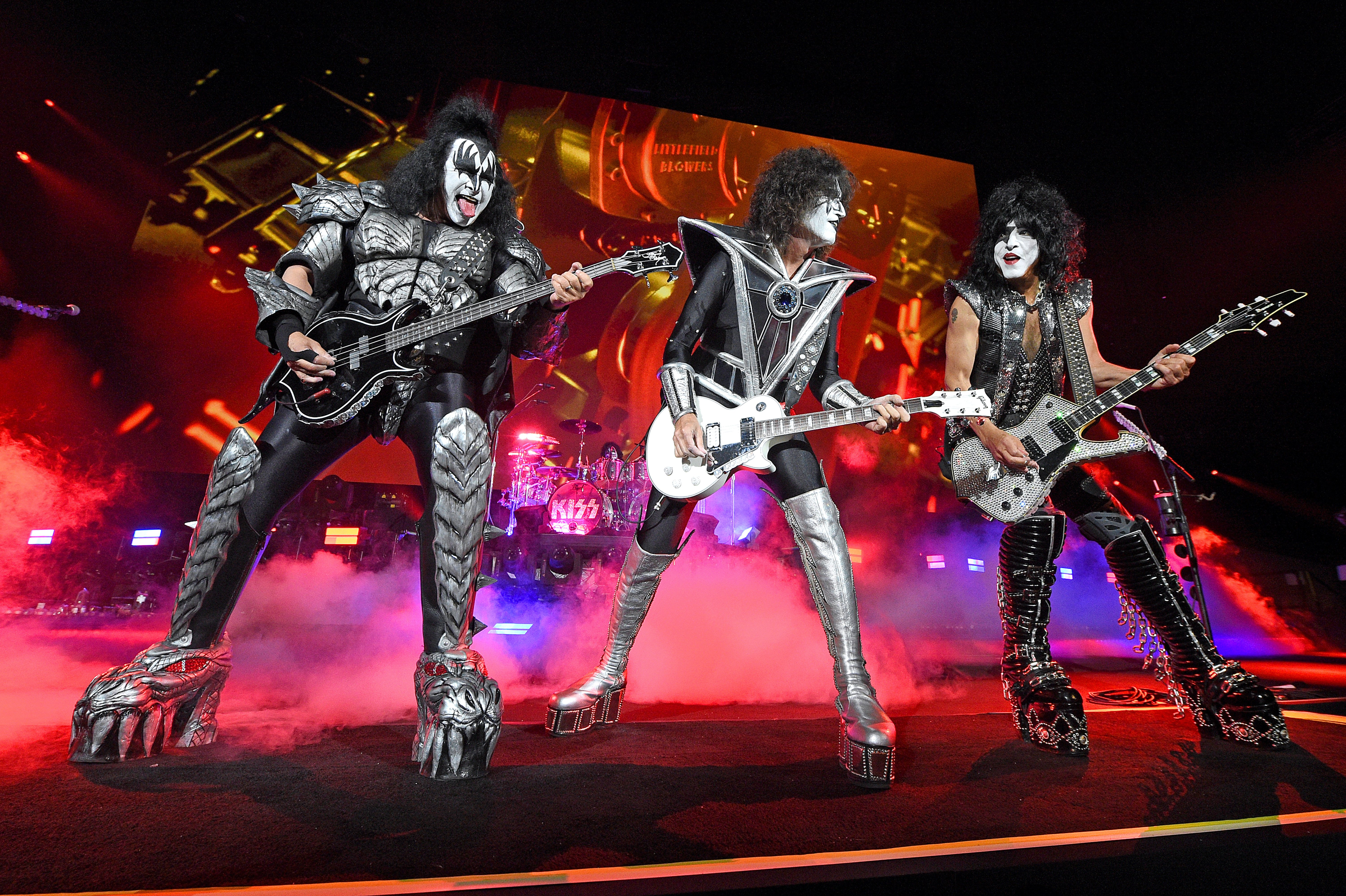 """Gene Simmons, Tommy Thayer, and Paul Stanley from KISS performing on stage during the Tribeca Festival screening of """"Biography: KISStory"""" at Battery Park in New York City 